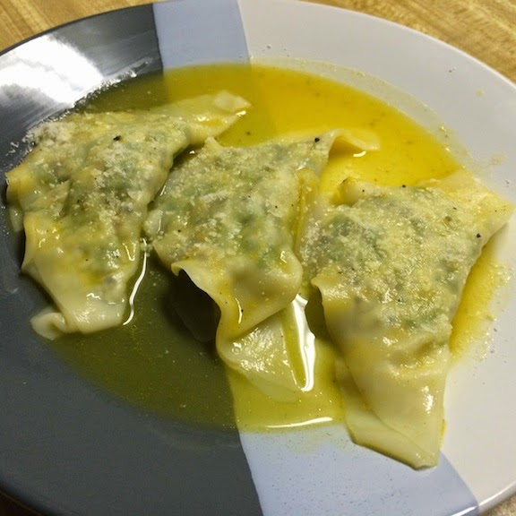 cheesy kale and quinoa wonton raviolis in butternut squash sauce