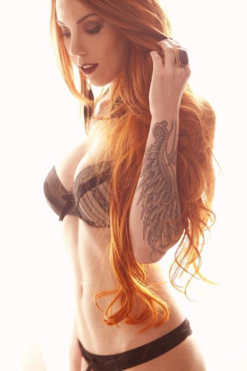 Hot Redhead Girl With Tattoos