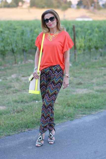 orange t-shirt, swaychic chevron pants, neon bucket bag, fashion and cookies