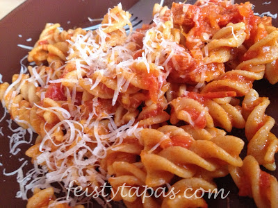 pasta twists, chorizo, chopped tomatoes, parmesan cheese,