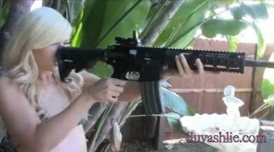 Blond army girl with a gun