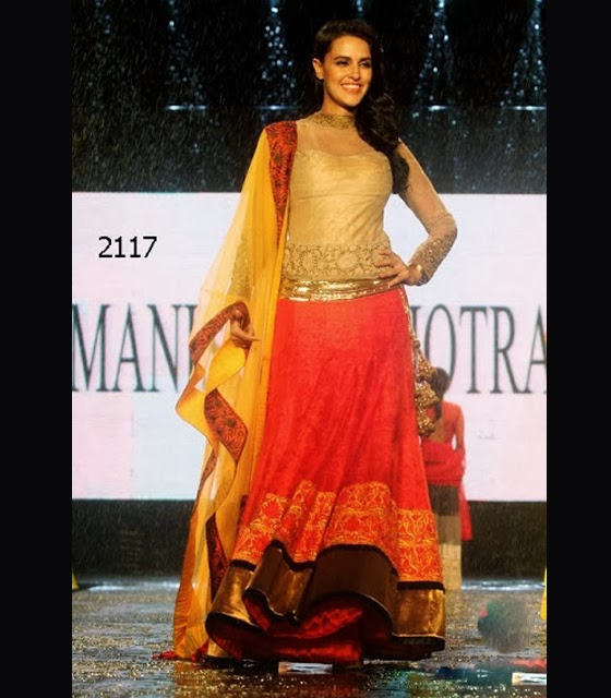 Neha Dhupia in Manish Malhotra orange and gold Lehenga