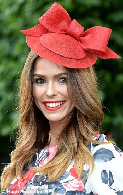 elegant lady in matching crismon hat and lipstick on day 2 of Royal Ascot 2014