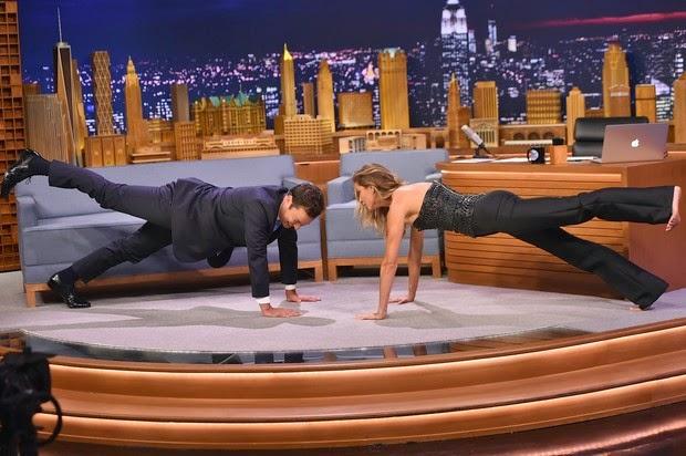Barefoot, Gisele Bundchen makes bridge and on TV show