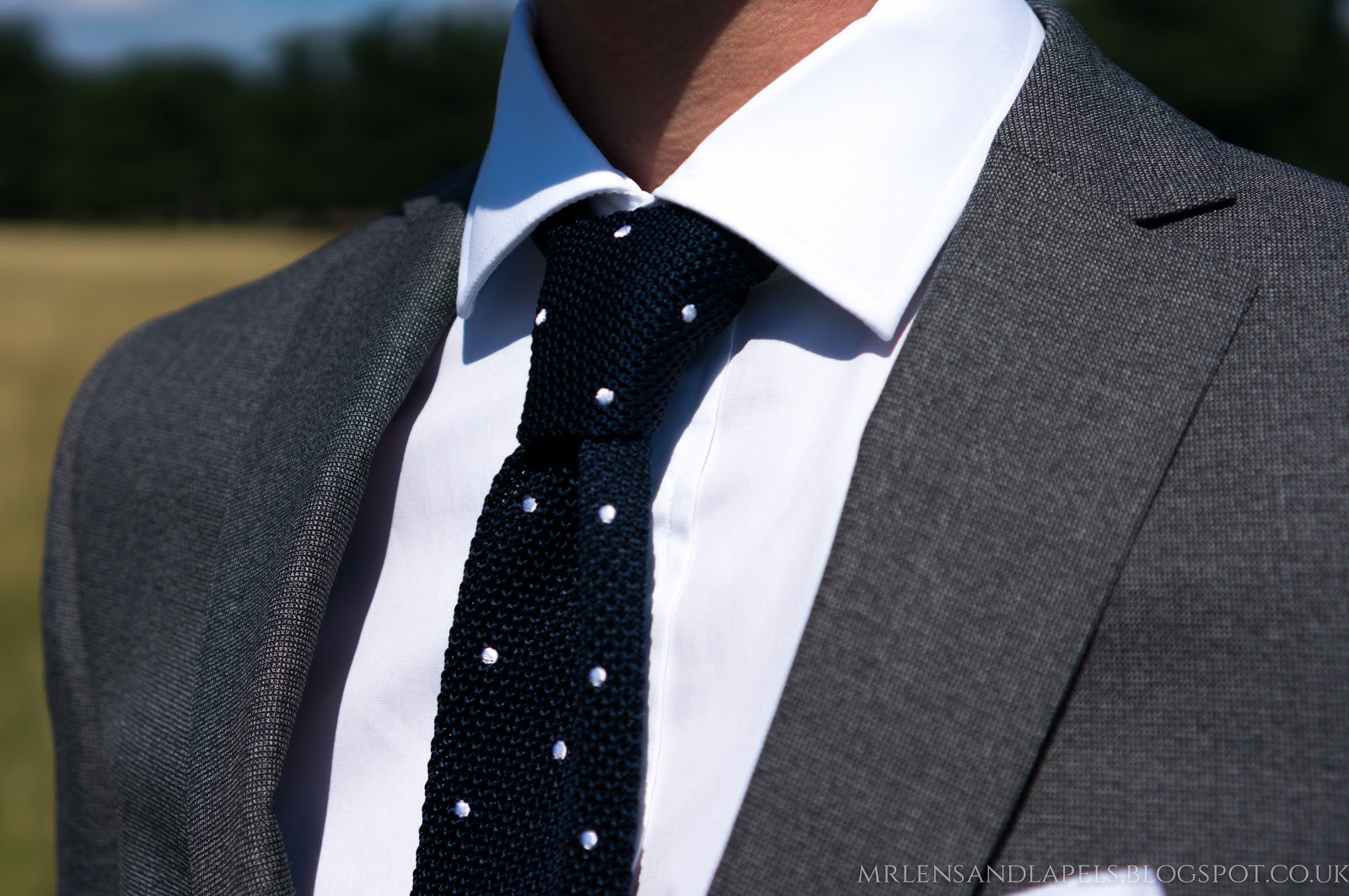 TM Lewin plain phoenix charcoal skinny fit suit navy knitted polka dot spotted tie white pocket square white shirt