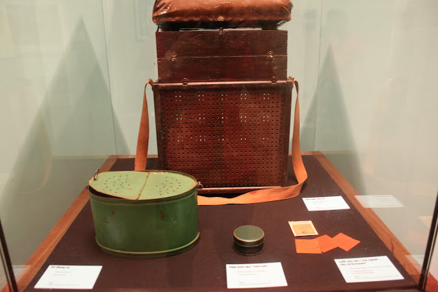 Fishing equipment such as fish and turtle bait box, fish trap and fishing hooks on display at Museum of Ethnology in Hanoi, Vietnam