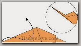 Bước 6: Gấp cạnh giấy vào trong giữa hai lớp giấy.