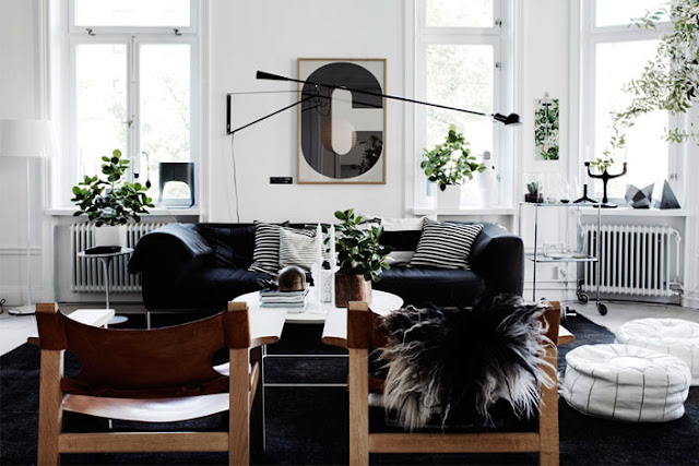 black and white living room leather sofa Moroccan ottoman pouf framed letter C wall decor art