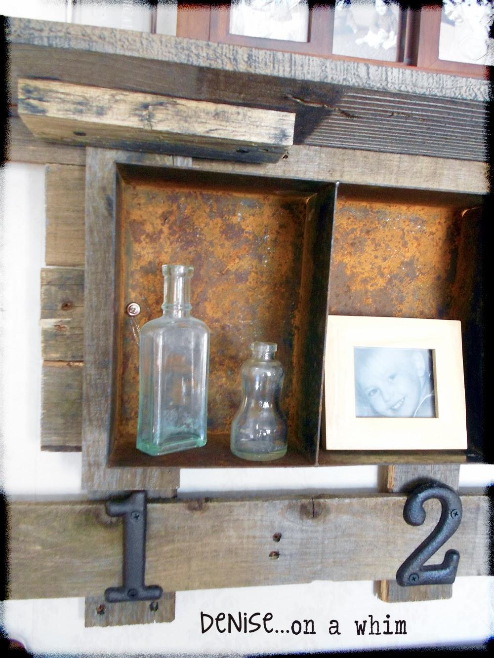 A rusty bin turned shelf for displaying small items via http://deniseonawhim.blogspot.com