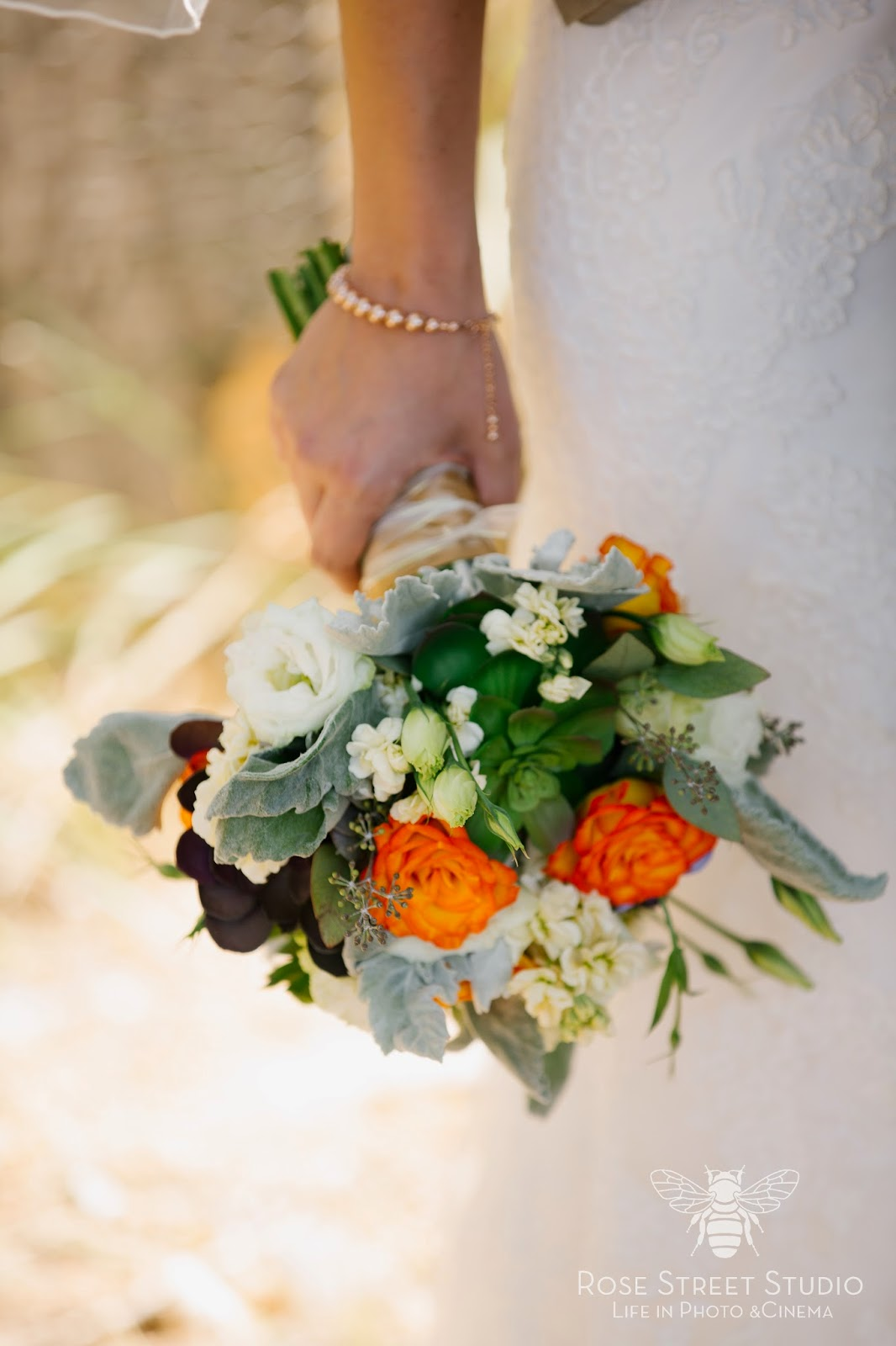 Orange, white, and succulent bridal bouquet l Rose Street Studios l Take the Cake Event Planning