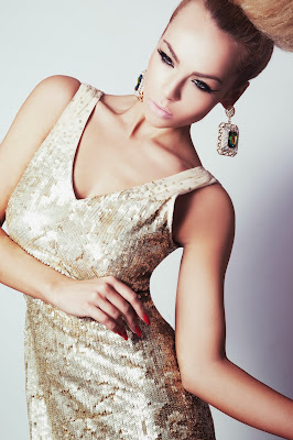 model builds her portfolio with a glamorous shoot wearing a glod sequinned dress with a slicked back big textured bun