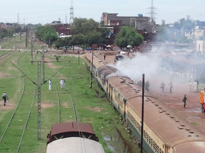 Pakistan-railways-boggie-burning-sherpao-bridge-far
