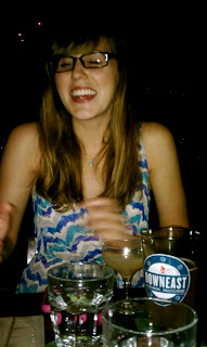 Awkwardly laughing at the flash in the dimly lit bar