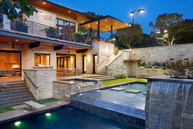 Picture of incredible pool elevations and fountains in front of the house