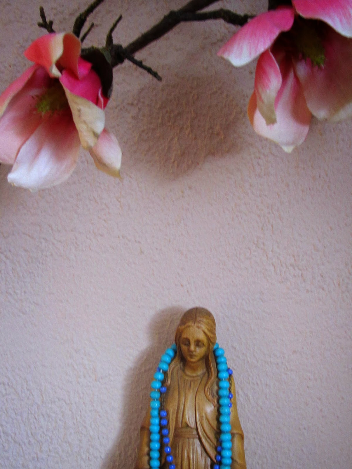 virgin Mary with flowers, rosary and mala