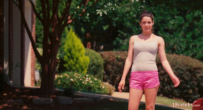 ali cobrin in grey top and pink shorts