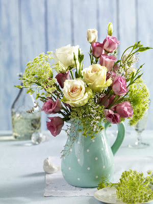 romantic table decoration with flowers for st. valentine's day