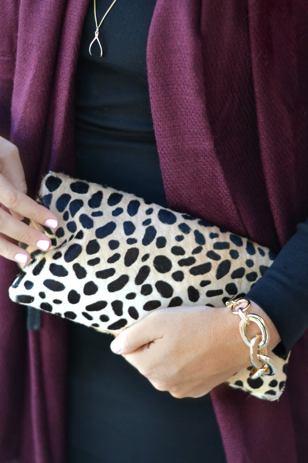 clare-v-leopard-clutch-with-gold-wishbone-necklace