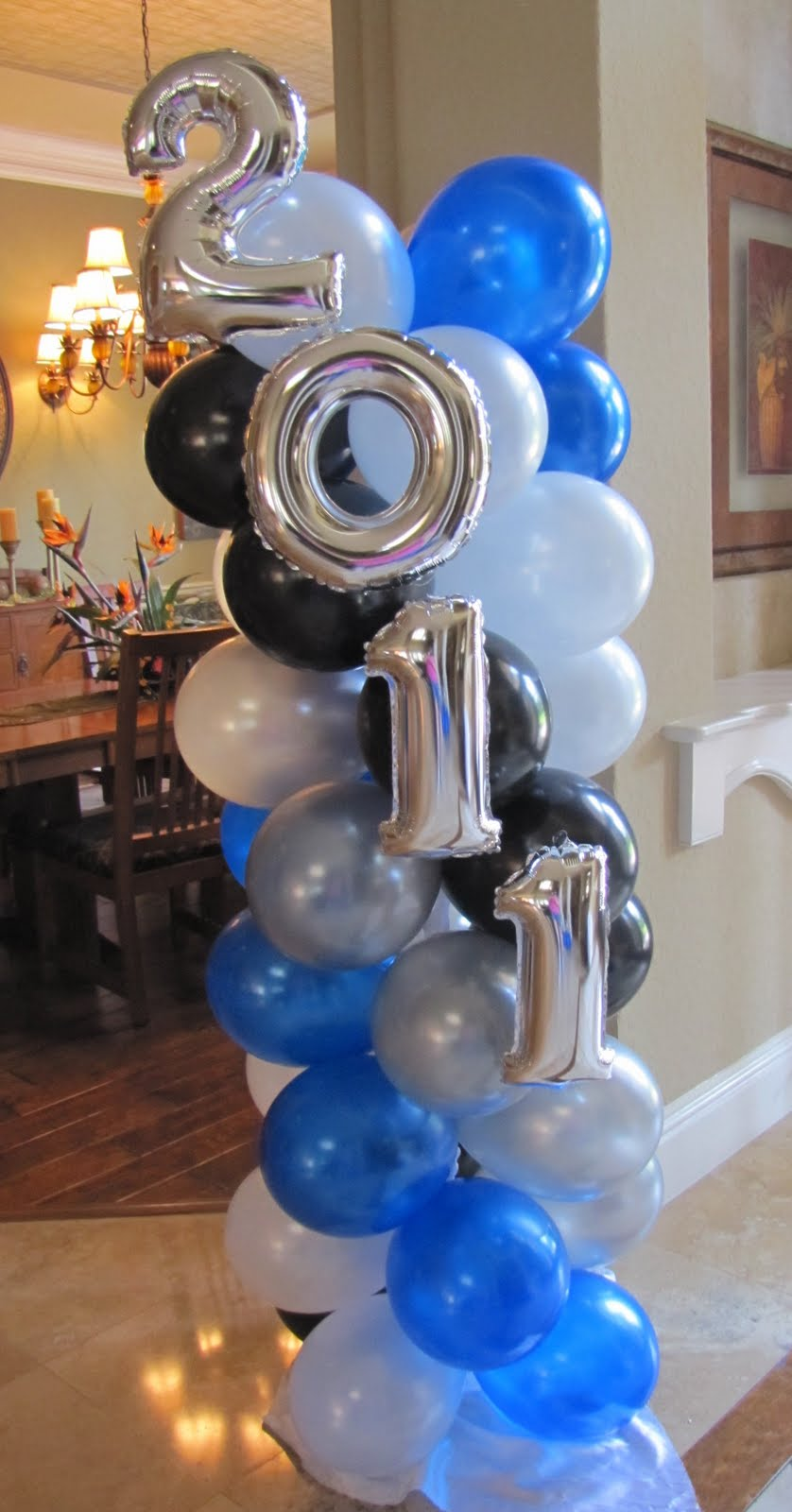 Graduation decoration ideas on pinterest graduation for Balloon decoration company