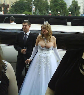 funniest pictures: bride in wedding dress with striking tits