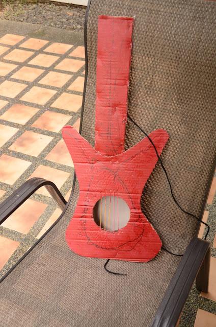 Kecil's red cardboard guitar