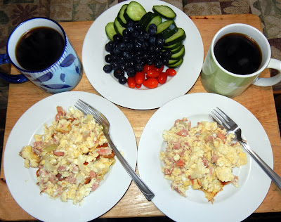 Scrambled eggs, cucumber and tomato slices, blueberries and coffee!