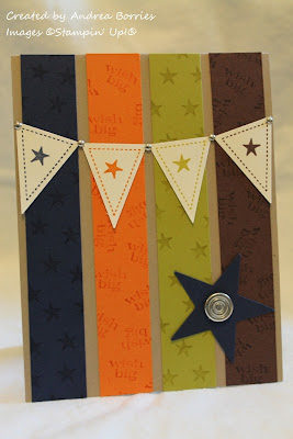Kraft card with strips of navy, orange, green and brown card stock. There is a banner with four pennants over the strips and a navy star in the bottom right corner.