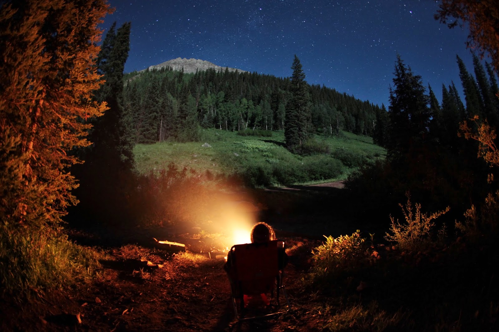 Enjoying a campfire under the stars at a remote campsite in the San Juan National forest southwest of Telluride.