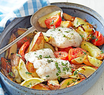tomatoes and herbs for a healthy and gluten Greek-style roast fish recipe