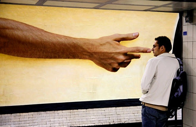 matt stuart london street photography moorgate underground big hand pointing nose