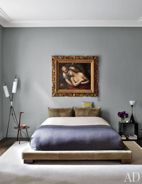 Master bedroom in Stefano Pilati of Zegna's Paris duplex with suede upholstered bed