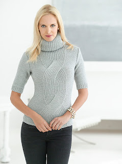 http://www.ravelry.com/patterns/library/fitted-cable-pullover