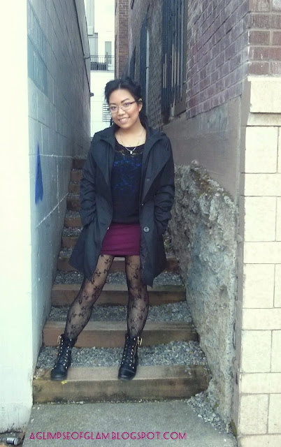 black raincoat outfit with maroon skirt and black fishnets