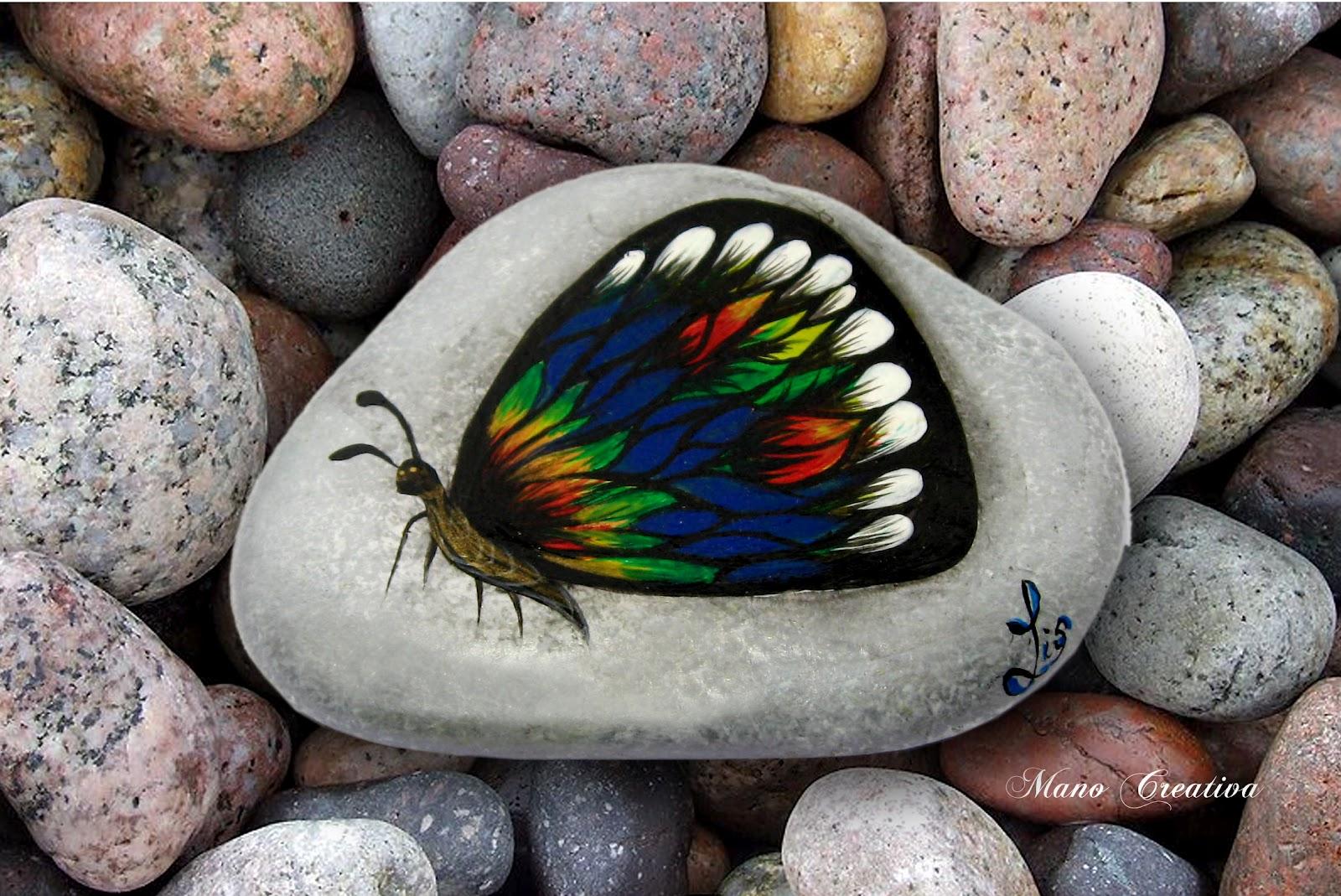 mano creativa pintura sobre piedras