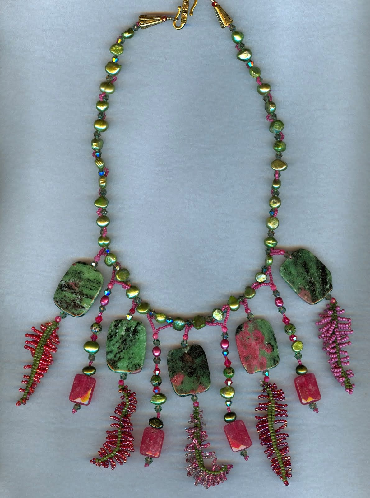 red green ferns and green gem stones