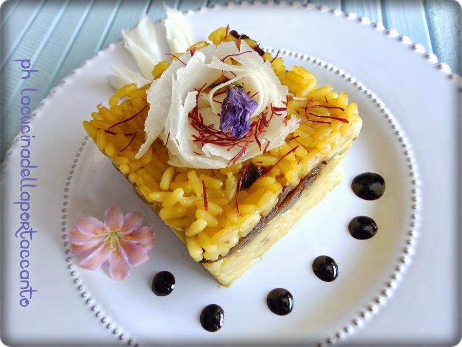 risotto con stimmi di zafferano, funghi porcini e raspadura lodigiana / risotto with saffron, porcini mushrooms and raspadura lodigiana