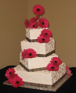 4 tier black and white wedding cake with pink daisies