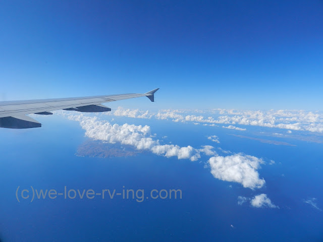 We fly into Santorini from Athens and see the blue sky meets the blue water and islands dot the sea