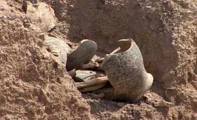 "A group of Iraqi archaeologists unearth valuable finds in a newly excavated site south of the capital Baghdad. The excavations initiative is part of a tourism project called ""Gardens of Eden"" which the Iraqi government plans to launch over the next few years [Credit: Reuters]"