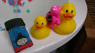 Bath toys: Thomas the tank engine, ducks and a pink tortoise