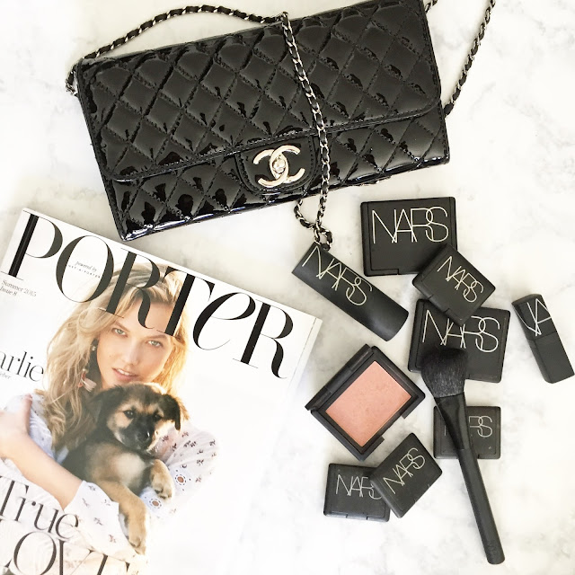 porter magazine flatlay, chanel black patent woc, nars unlawful blush
