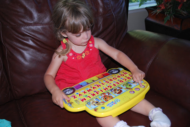 child playing with LeapFrog Learning Bus