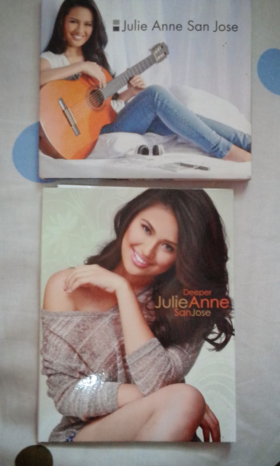 front covers of Julie Anne San Jose and Deeper albums