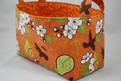 fabric bin, orange, with flowers and birds