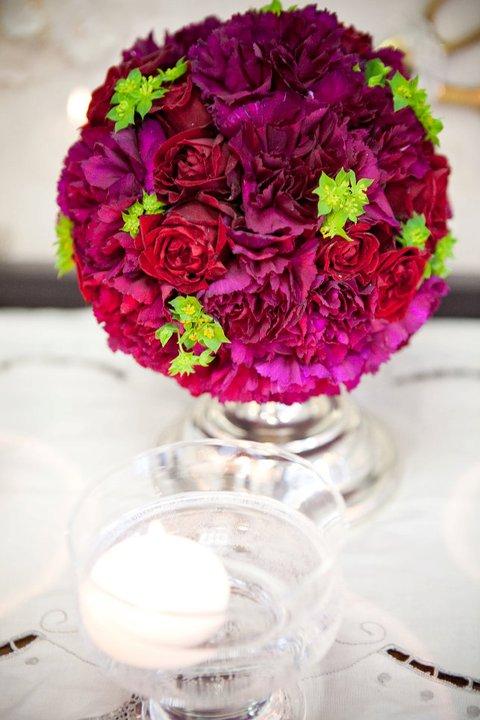 ann arbor wedding florist, detroit, south east Michigan wedding florist, red roses, purple carnations, green buplerum, silver candlestick , candle,sweet pea floral design