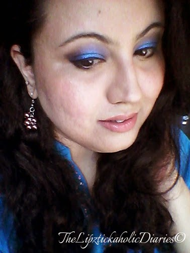 Shimmery Blue eyes and N*de lips (Party Makeup look) image