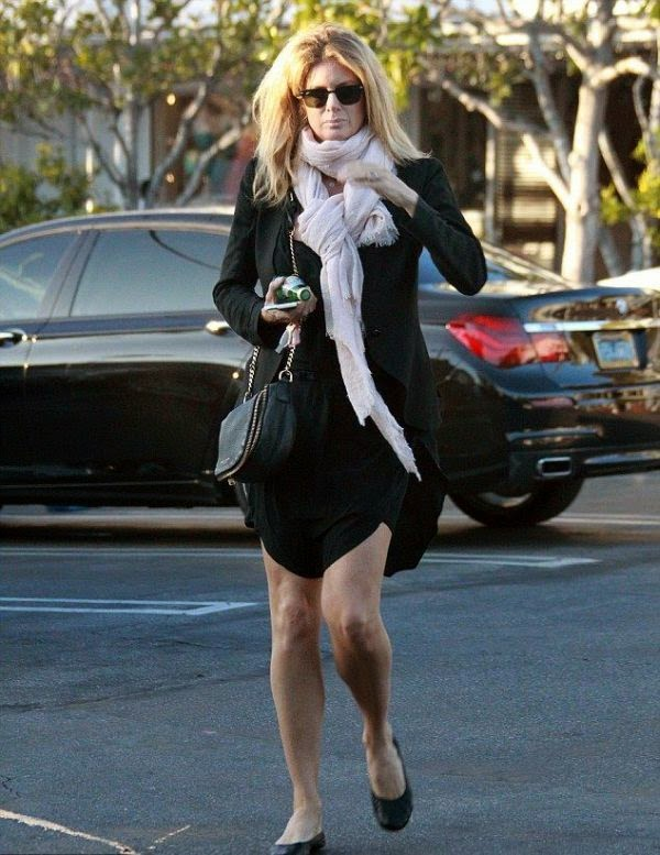 The Supermodel was seen enjoying her another strolling look in a dark dress at West Hollywood in California, USA.