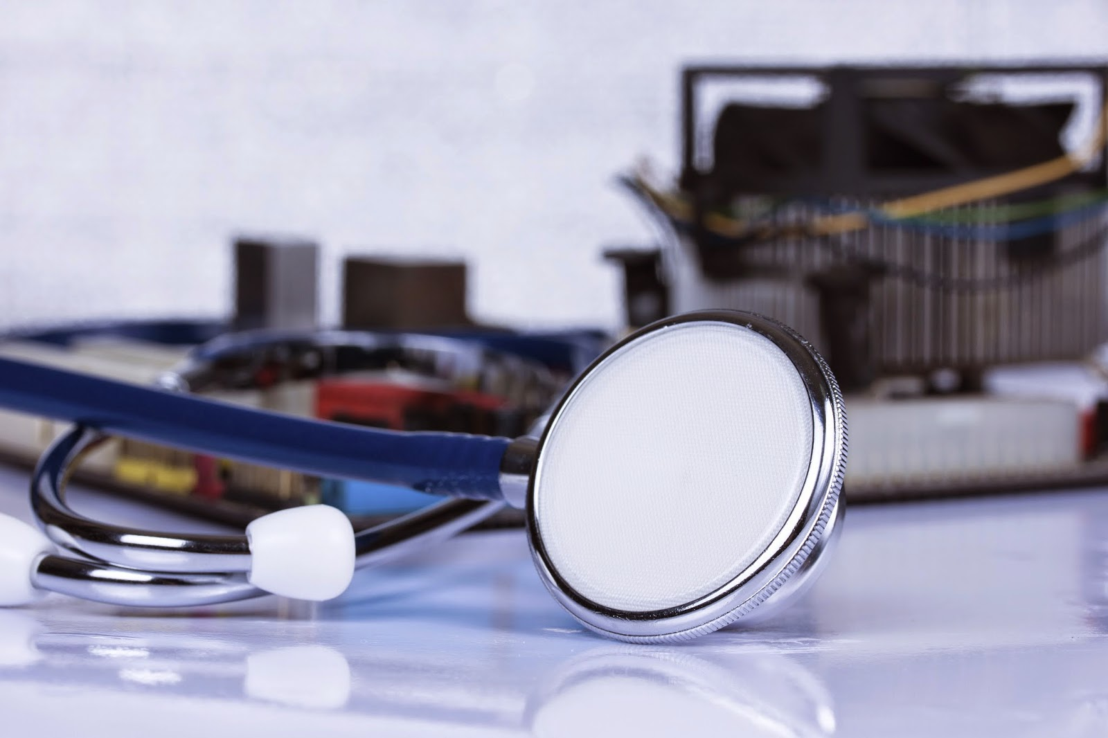 image of a Stethoscope in front of computer hardware