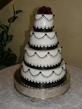 4-tier round fondant with black accents
