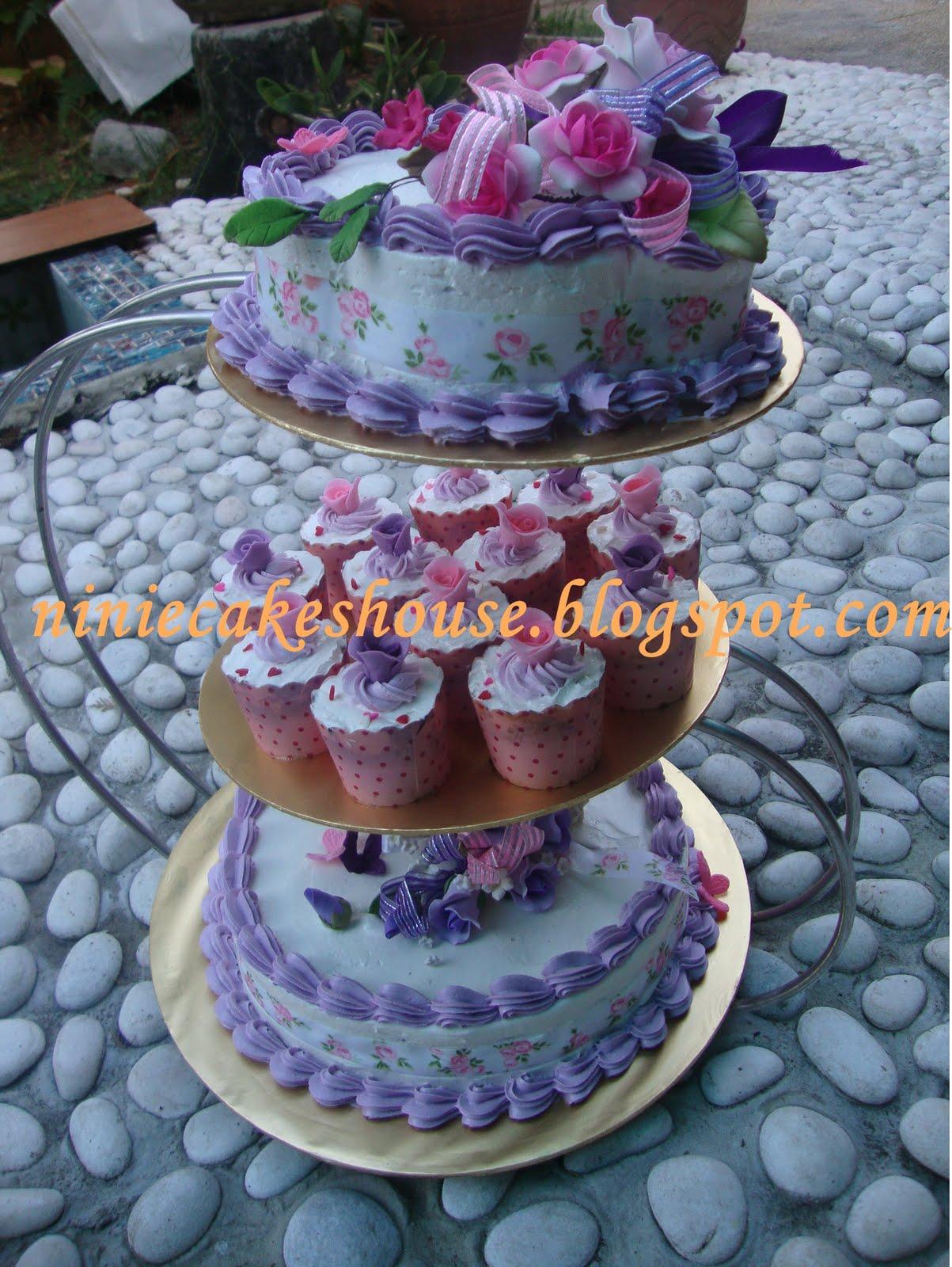 ninie cakes house 3 Tier Wedding Cakes purple and pink